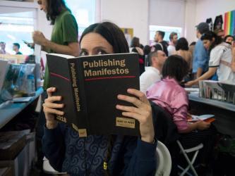 Tauba Auerbach holding Publishing Manifestos, October 2018